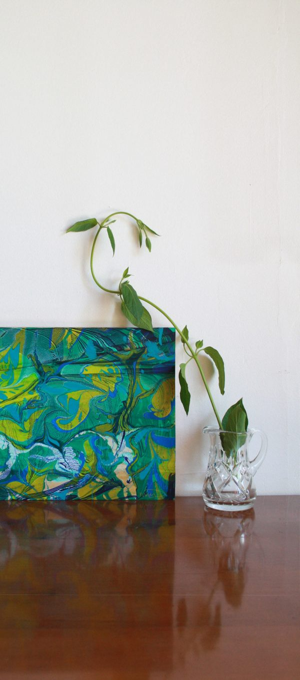 hand marbled paper in teal, greens, yellows, blues and whites