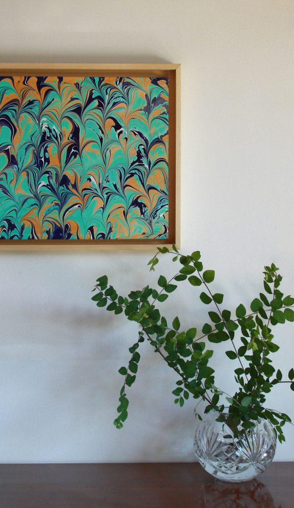hand marbled paper in teal, blue, mustard yellow and white