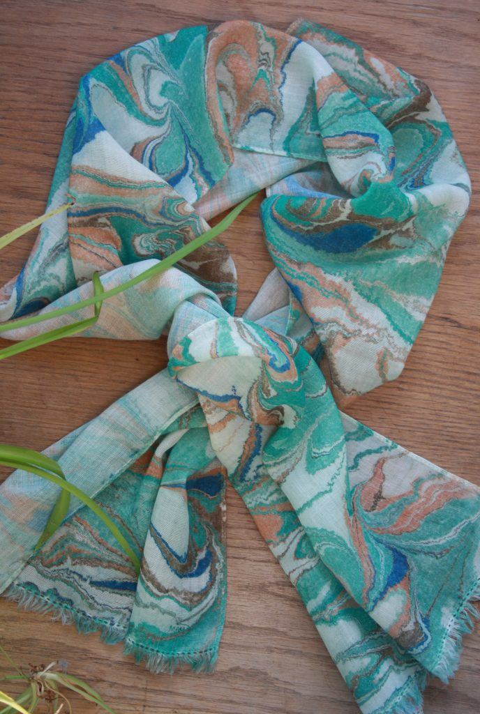 hand marbled merino wool scarf in nuances of teal, blue, ochre and white