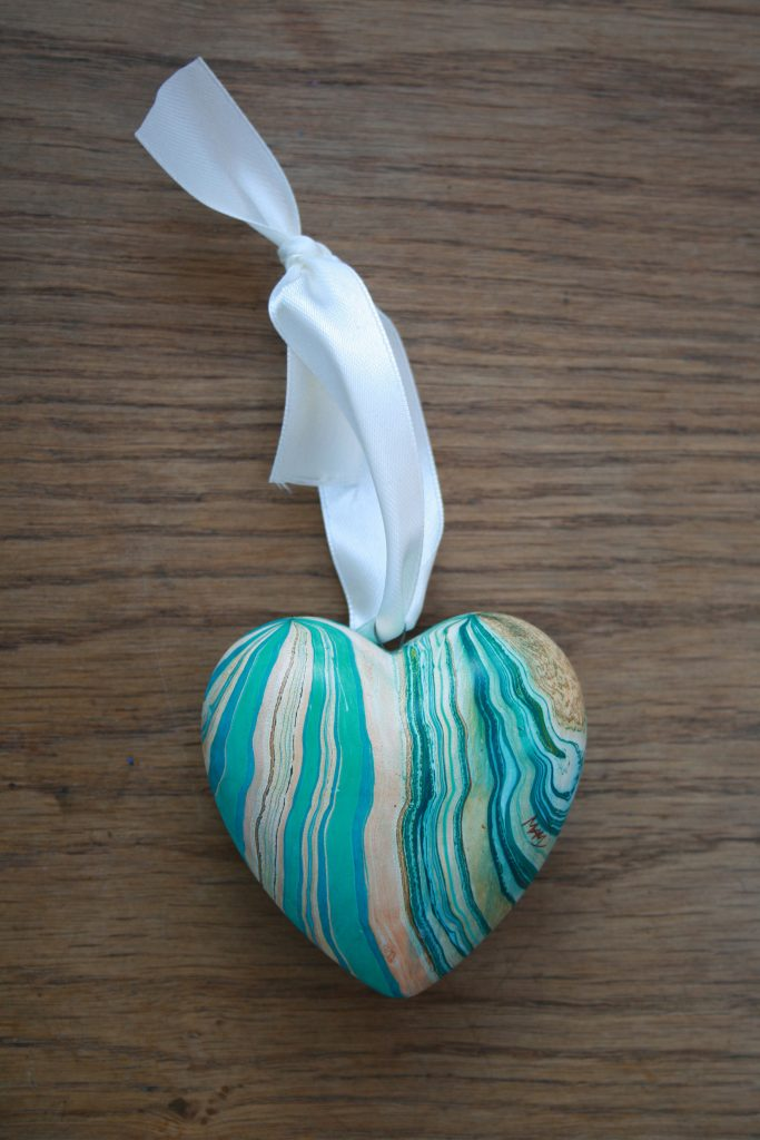 hand marbled heart ornaments in teal, greens, ochre, white
